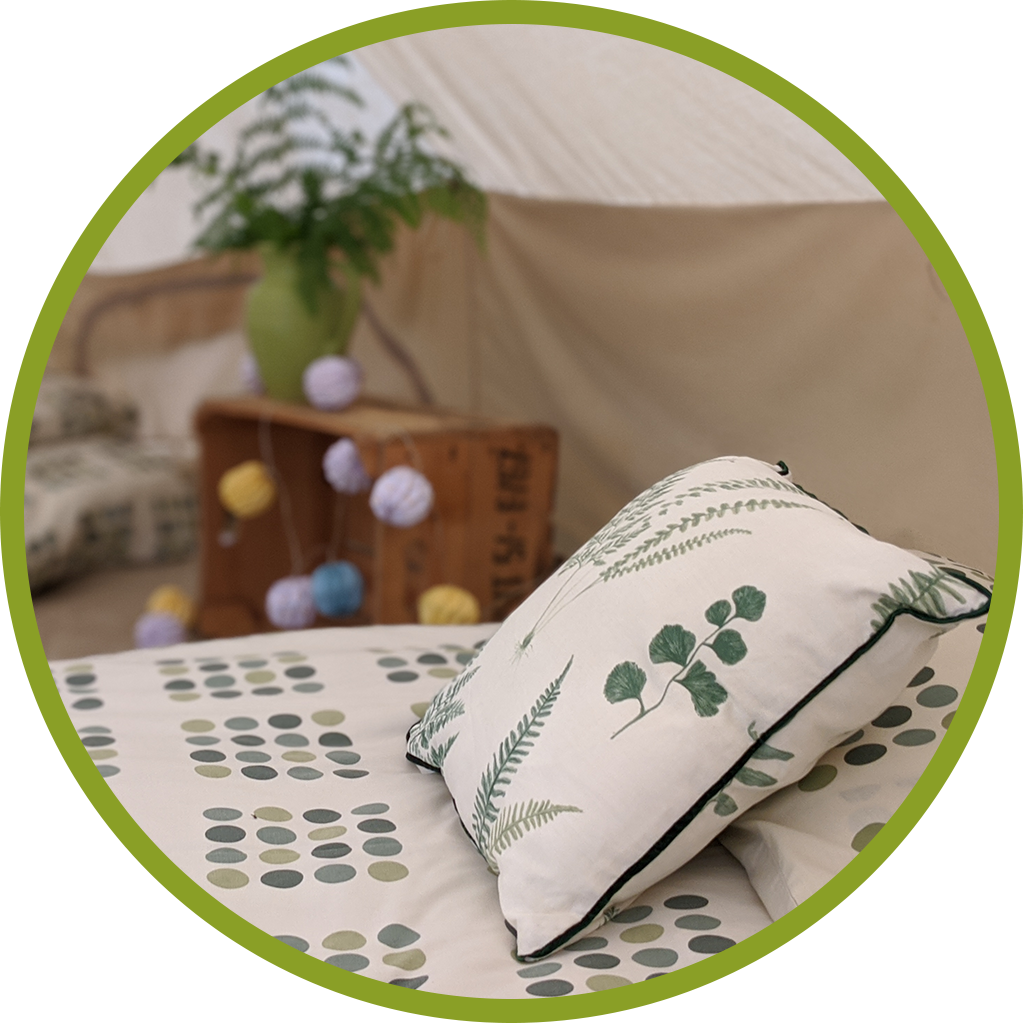 Close up of a bed in a glamping tent