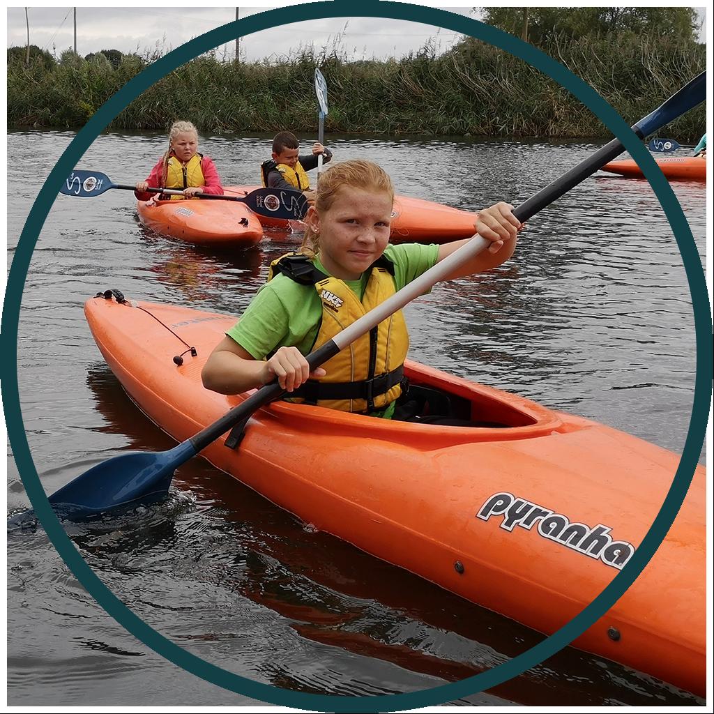 Young girl kayaking